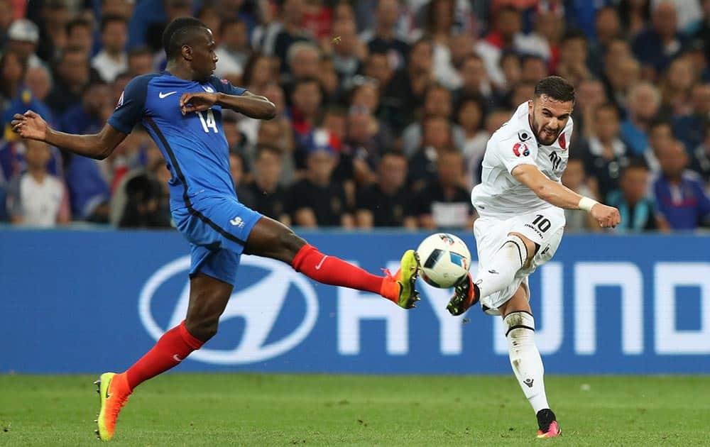 France's Blaise Matuidi, left, goes for the ball against Albania's Armando Sadiku during the Euro 2016