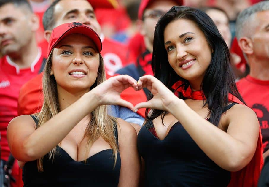 Two Albanian supporters pose as they wait for the start of the the Euro 2016