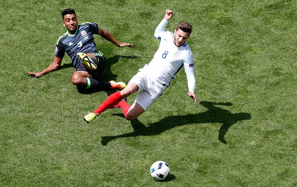 England's Adam Lallana, right, is tackled by Wales' Neil Taylor during the Euro 2016
