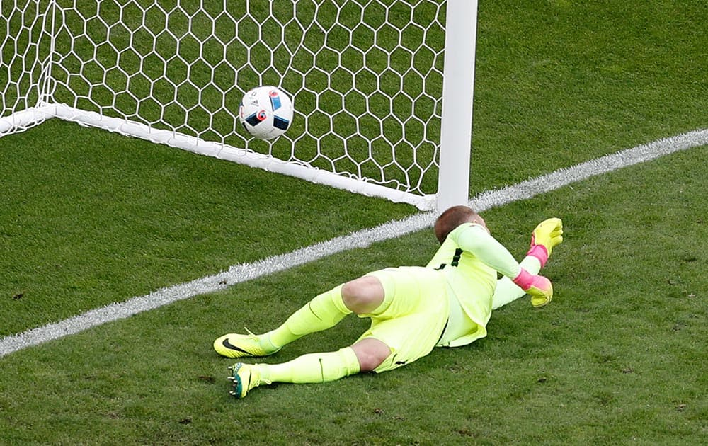 England goalkeeper Joe Hart fails to make a save as Wales' Gareth Bale scores the opening goal during the Euro 2016