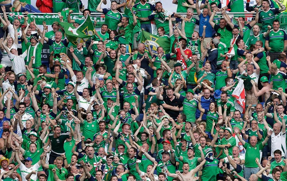 Northern Ireland supporters celebrate their side's second goal during the Euro 2016