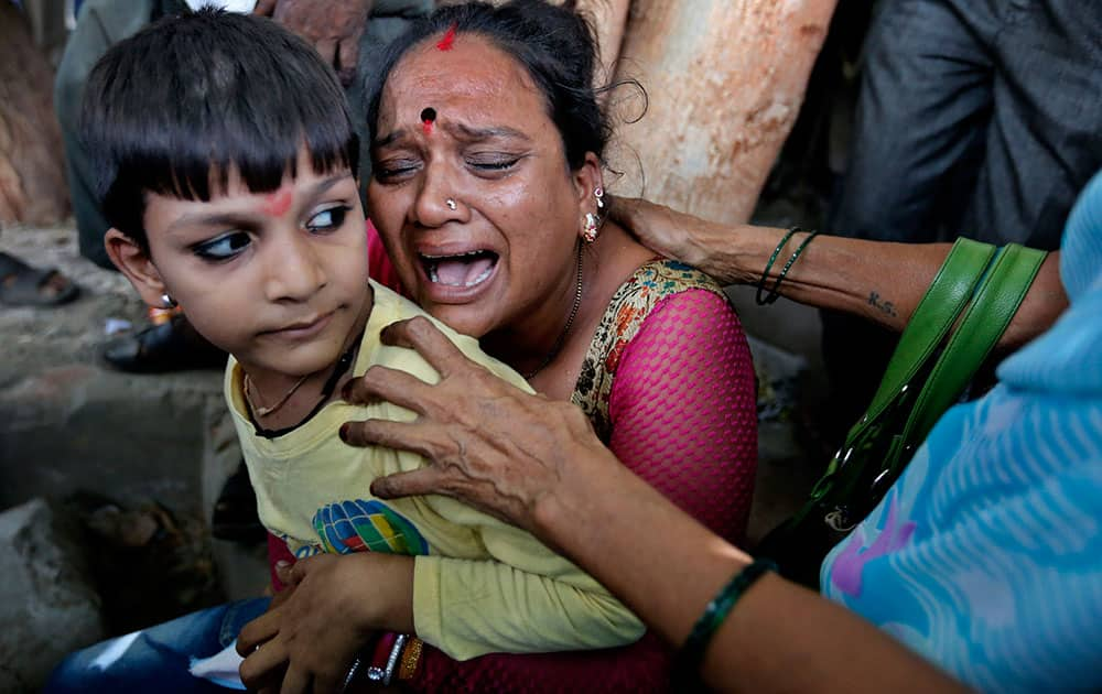A relative of a man convicted for the 2002 Gujarat riots cries