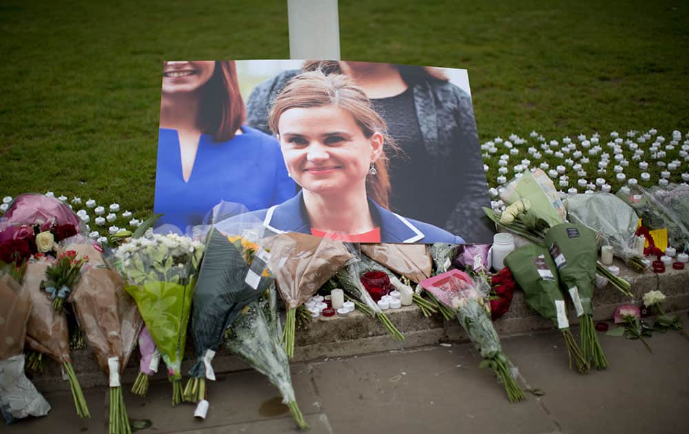 An image and floral tributes for Jo Cox