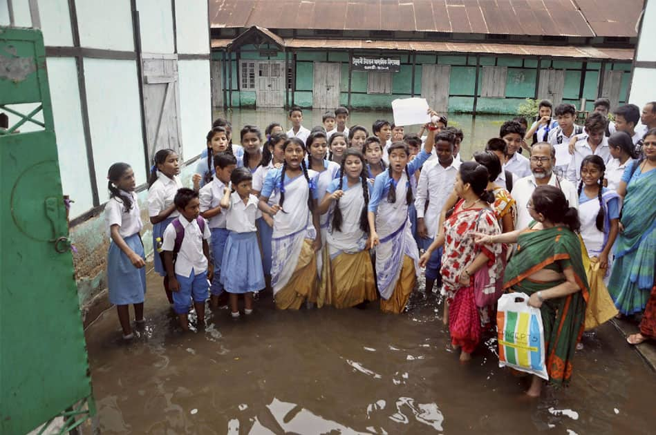 Students and teachers of Ulubari Higher Secondary School demanding to solve the regular problem of water logging