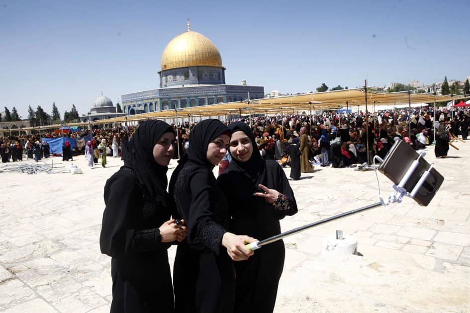 Palestinian women take a picture during the Muslim holy month of Ramadan