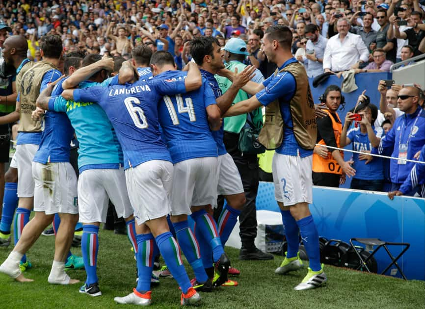 Italy players celebrate after Eder, center, scored the opening goal