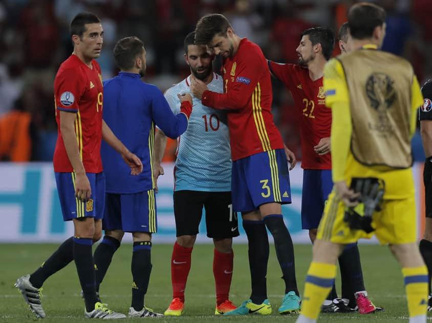 Gerard Pique hugs his FC Barcelona teammate Turkey's Arda Turan