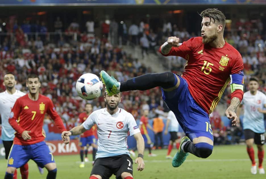 Spain's Sergio Ramos reaches for the ball