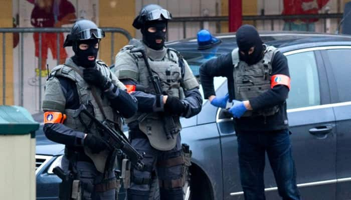 Belgium stages dozens of anti-terror raids, 12 held