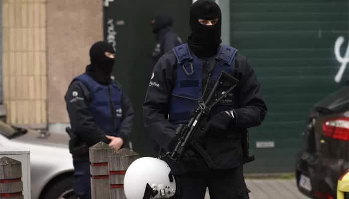 Belgium stages dozens of anti-terror raids, 12 people held