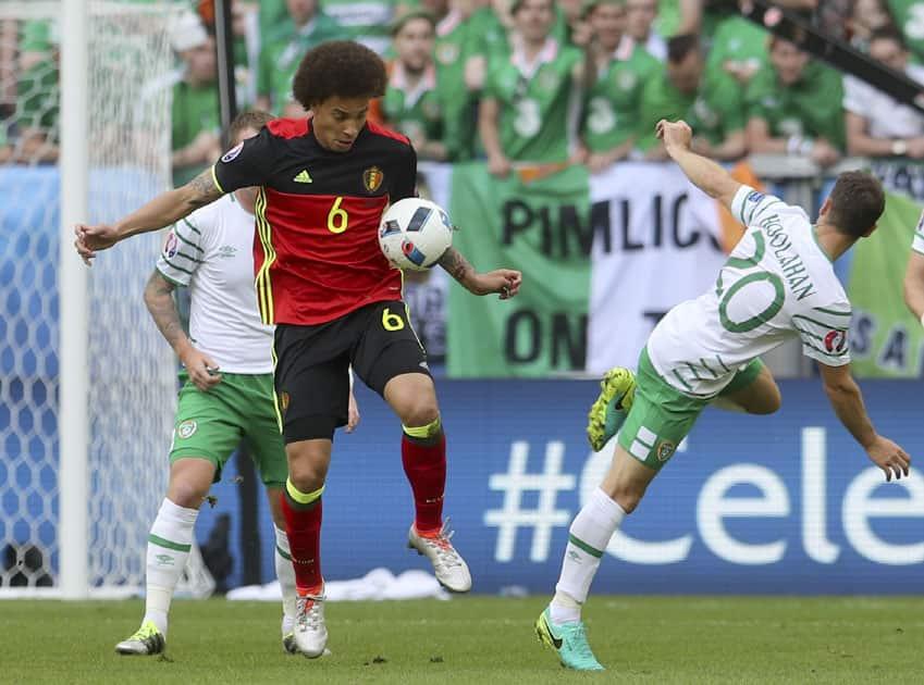 Belgium's Axel Witsel, left, blocks a shot by Ireland's Wes Hoolahan
