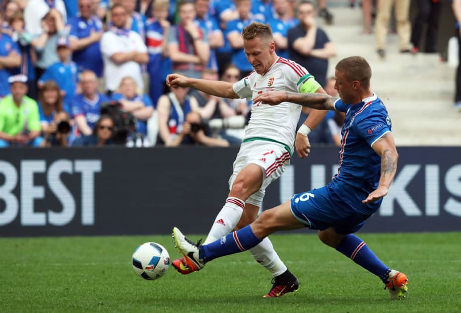 Hungary's Balazs Dzsudzsak, left, fights for the ball with Iceland's Ragnar Sigurdsson