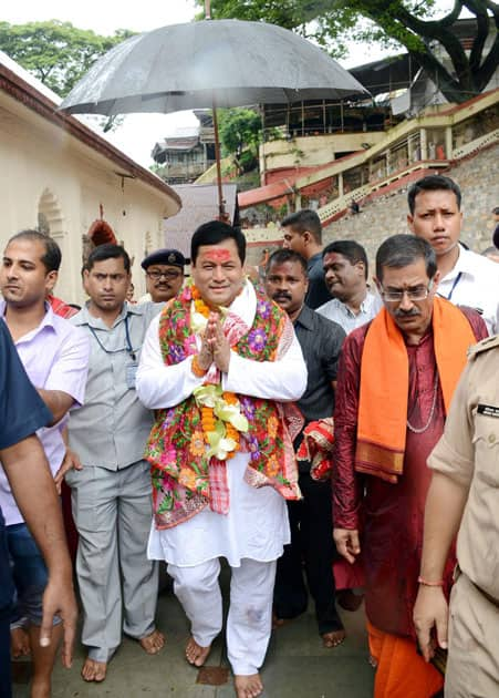 Assam CM Sarababada Sonowal coming out after offering prayers at Kamakhya temple