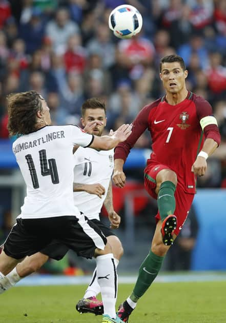 Cristiano Ronaldo, right, goes for the ball