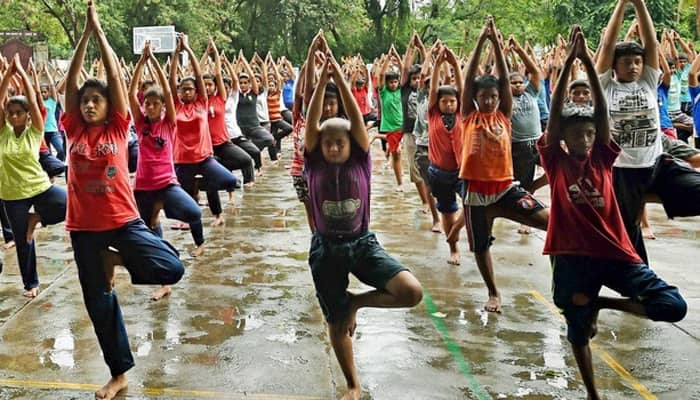 HRD Minister Smriti Irani asks parents, teachers to spend time with children practising yoga