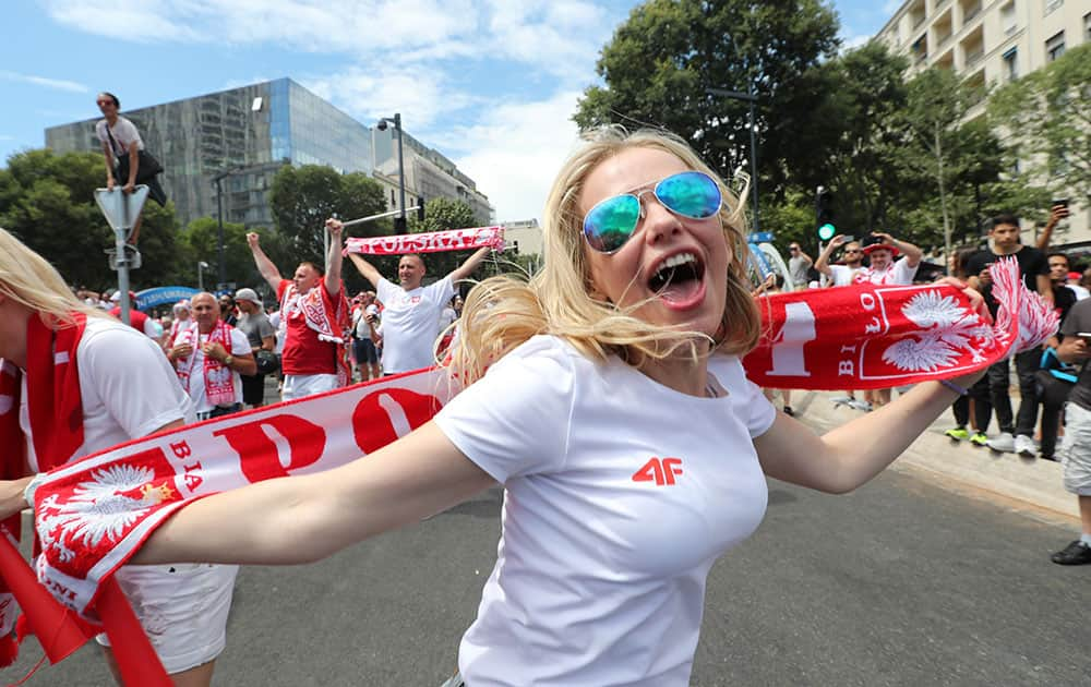 A Polish fan cheers for her team outside the Velodrome stadium