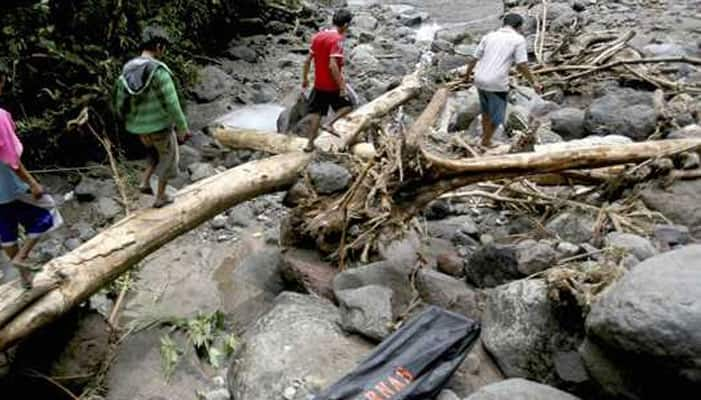 Deaths in Indonesia landslides, flood rise to 56 with nine still missing