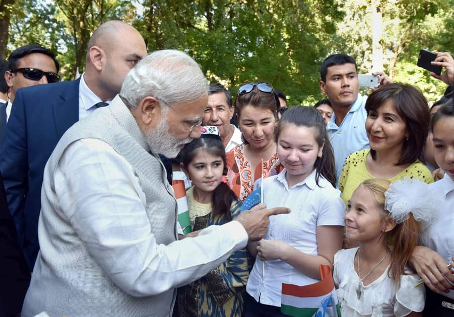 Prime Minister Narendra Modi interacts with Indian community children
