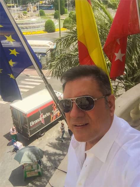On my room balcony posing with the freshly brexited EU flag- Boman Irani