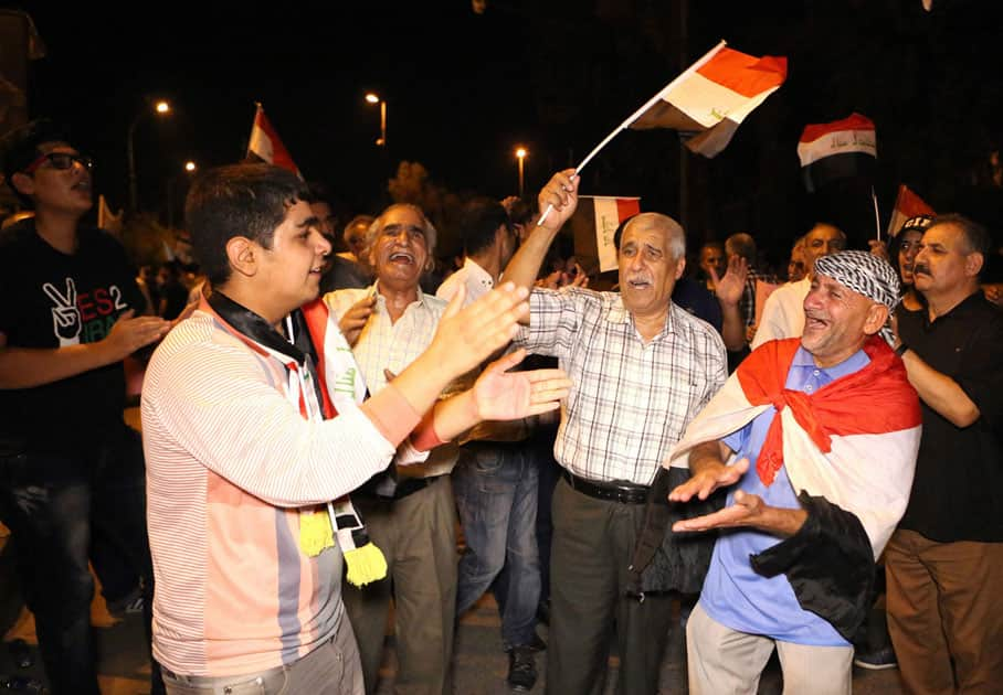 Protesters chant slogans calling for governmental reforms