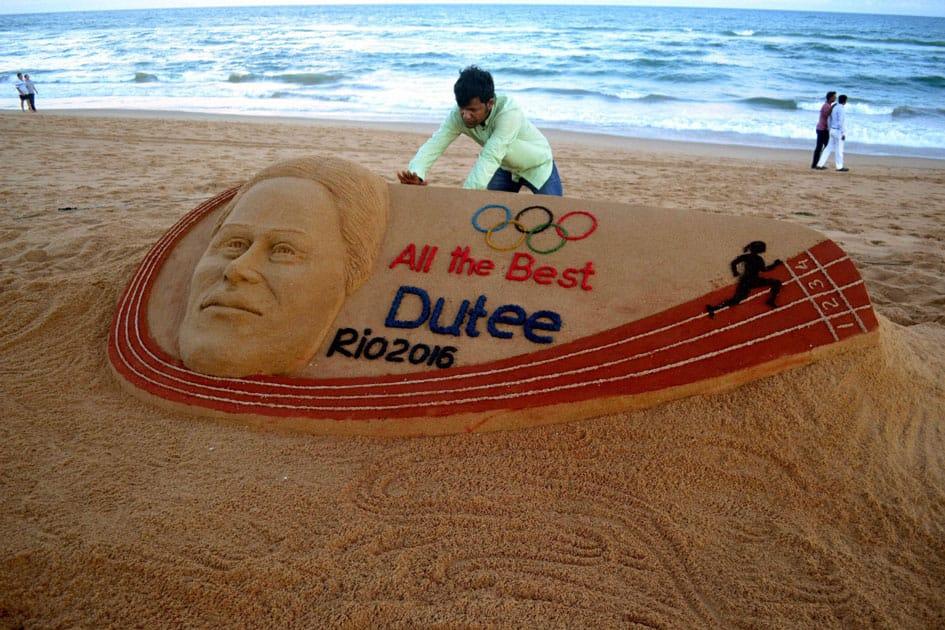Sudarsan Pattnaik creates a sand sculpture