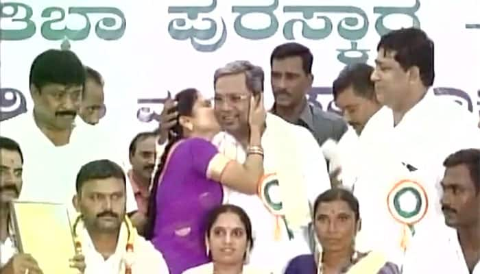 Oops! Karnataka CM Siddaramaiah gets kissed by woman in public — Watch video