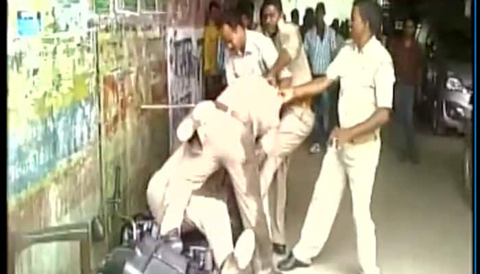 UP cops fight publicly over 'share of bribe', video goes viral - Watch
