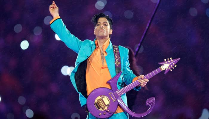 Prince's guitar, Bowie's hair fetch USD 150,000 at auction