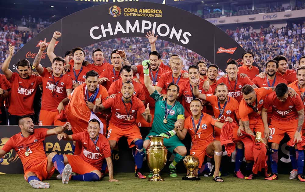 Chile players celebrate with their trophy