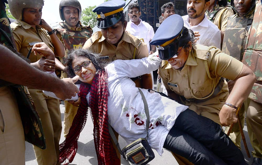 Police detain the Youth Congress members during their protest