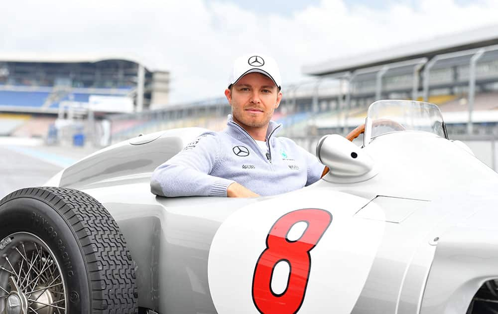 German Formula One driver Nico Rosberg poses in a historical racing car