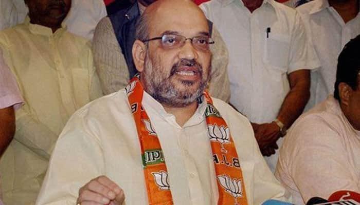 Shiv Sena mocks Amit Shah on 'Sholay' posters, BJP warns of `fitting reply`