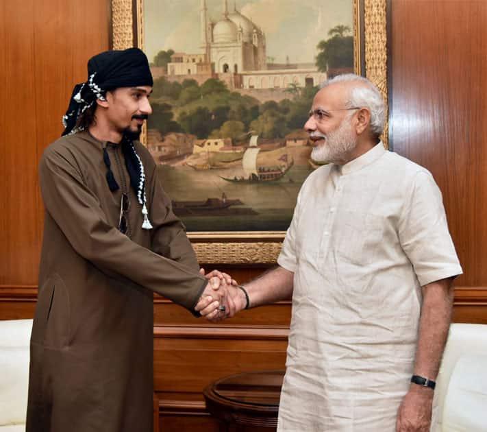 Narendra Modi shakes hands with Sultan Ahmed Al Mahmodi
