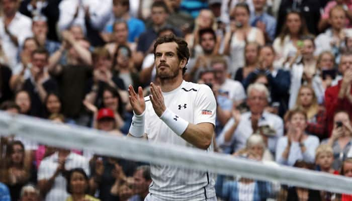 Andy Murray centre stage as wet Wimbledon plays catch-up