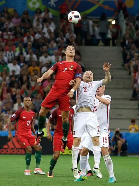 Cristiano Ronaldo, left, jumps for the ball