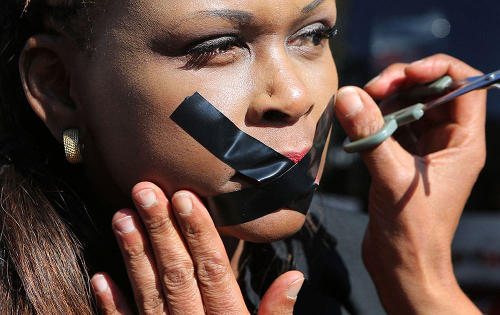 A protester has her lips taped in Johannesburg