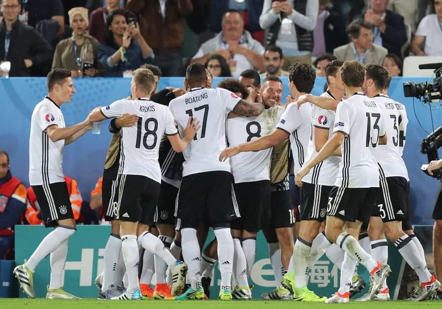 German teammates celebrate after scoring