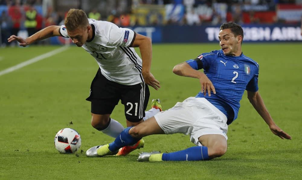 Italy's Mattia De Sciglio, right, challenges Germany's Joshua Kimmich