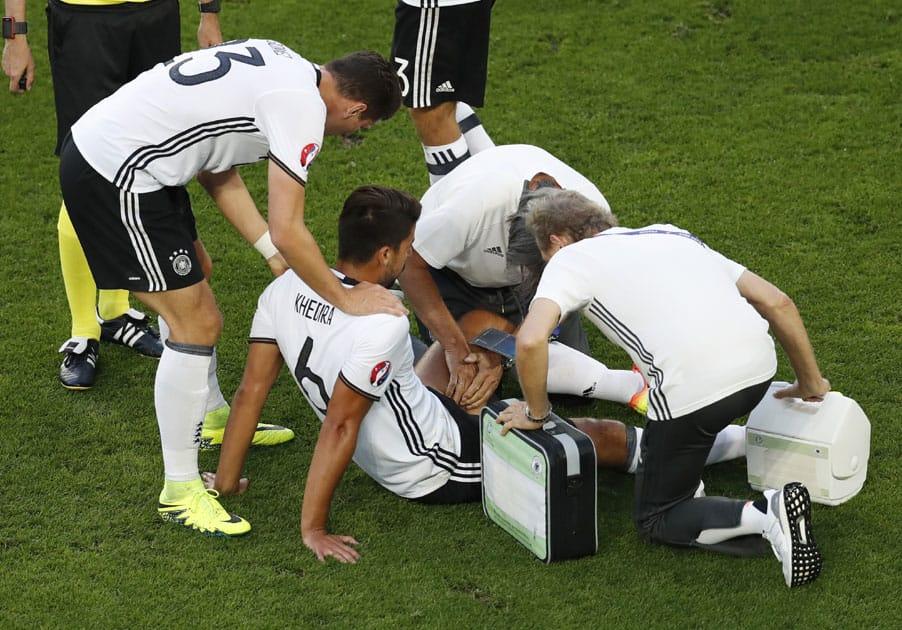 Germany's Sami Khedira gets assistance after getting injured