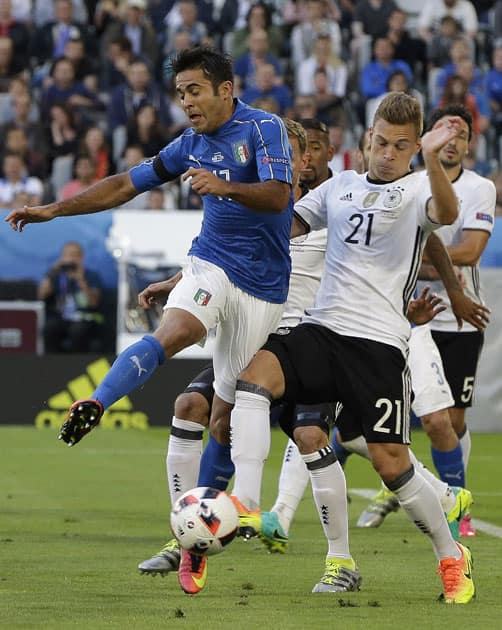 Italy's Eder, left, and Germany's Joshua Kimmich challenge for the ball