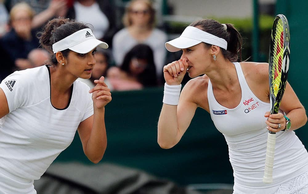 Martina Hingis and Sania Mirza on day eight of the Wimbledon Tennis Championships