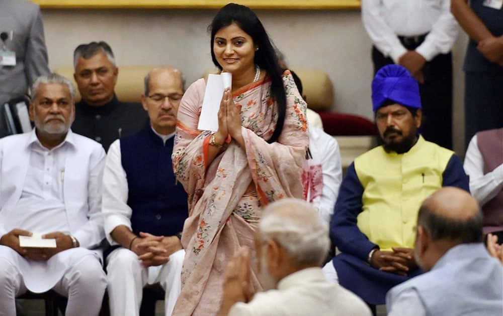 Apna Dal leader Anupriya Patel greets Prime Minister Narendra Modi as she walks to take the oath