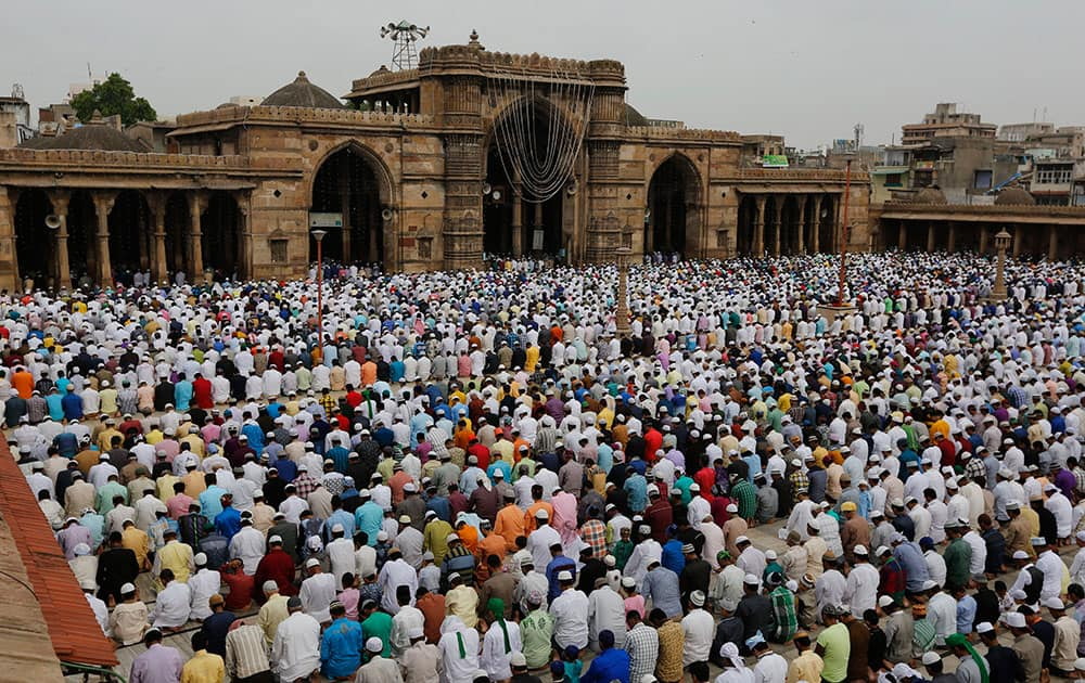 Muslims offer Eid al-Fitr prayers at the Jama Mosque in Ahmadabad