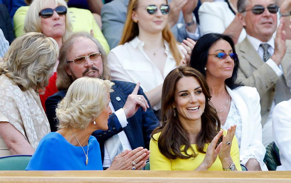 Kate, the Duchess of Cambridge applauds in the Royal Box on day eleven of the Wimbledon