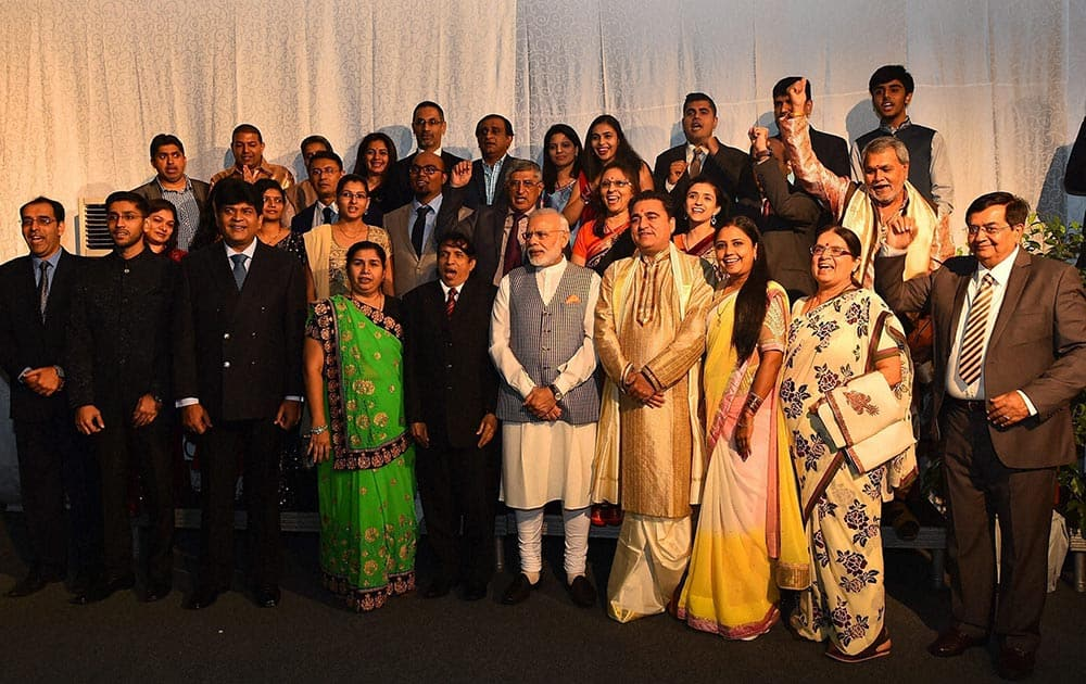 Prime Minister Narendra Modi pose for a photo during an interaction with Indian community in Maputo, Mozambique.