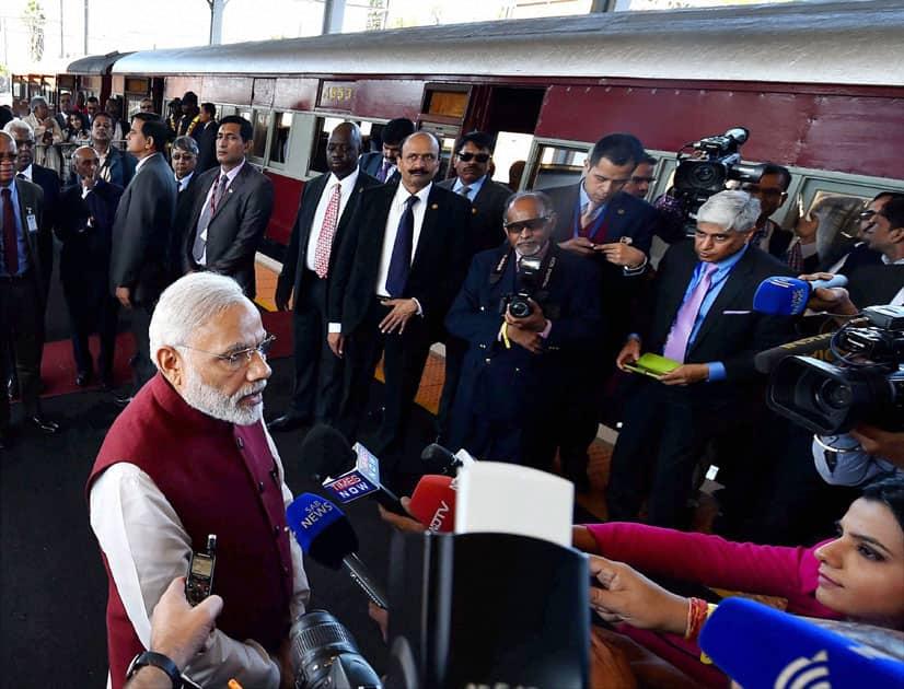Narendra Modi speaks to the press