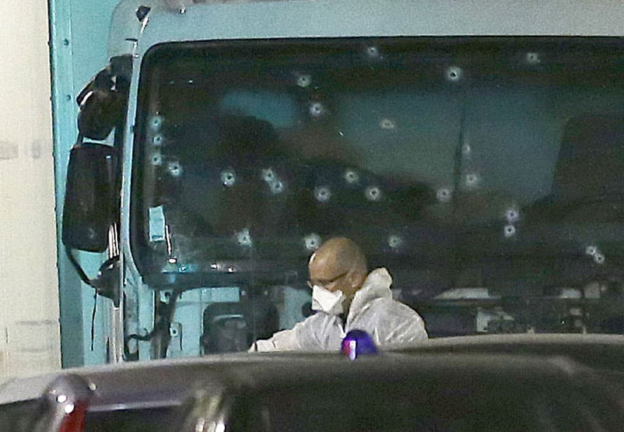 forensic officer stands near a van