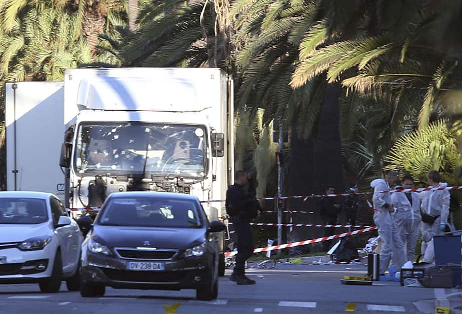 The truck which slammed into revelers is seen near the site of an attack