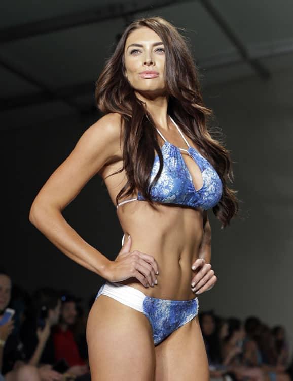 A model shows off her Just Bones Boardwear, Ocean Collection swimwear duringMiami Swim Week.