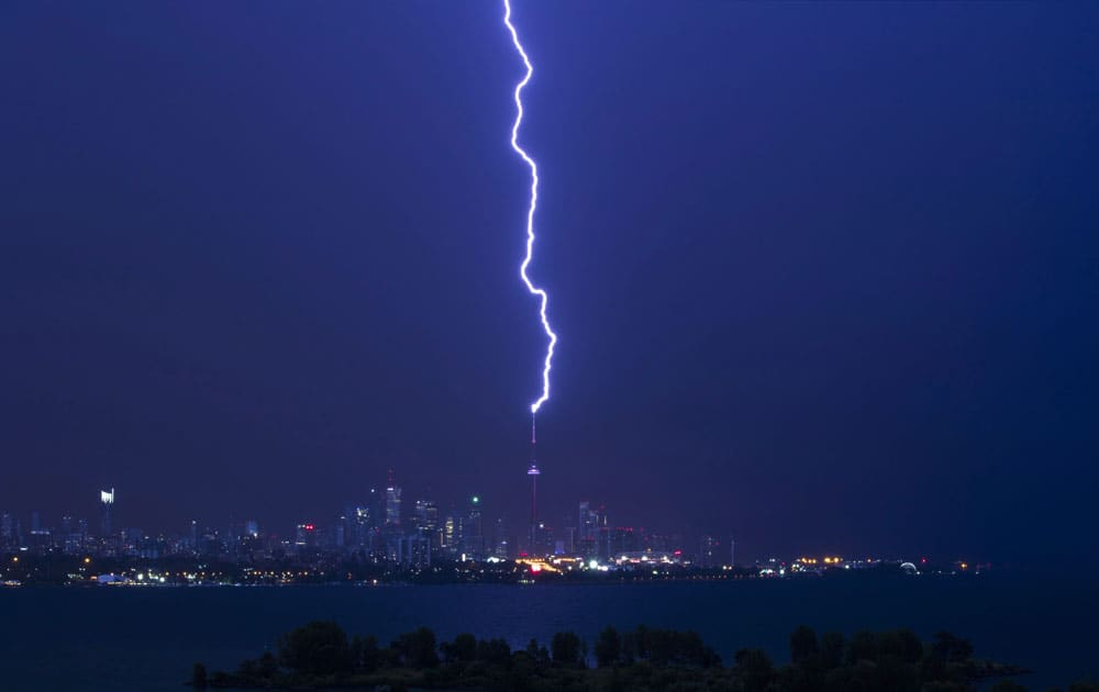 A lightning bolt strikes the CN Tower during an electrical storm in Toronto